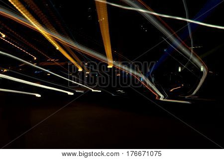 street lights explosion of gold and white at night zoom out effect abstract
