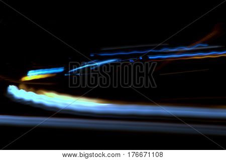 car lights in motion street scene abstract at night
