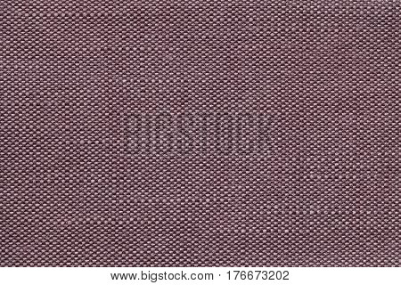 Brown and white background with checkered pattern closeup. Structure of the fabric with checkerboard pattern macro.