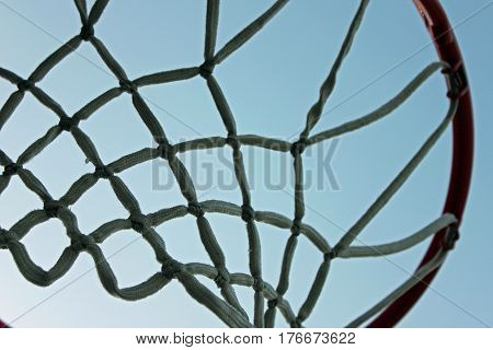 Basketbal Hoop Silhouette Against a Clear Sky