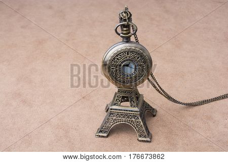 Little Model Eiffel Tower  And A Pocket Watch