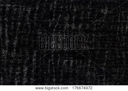 Black background of soft fleecy cloth. Texture of textile closeup.