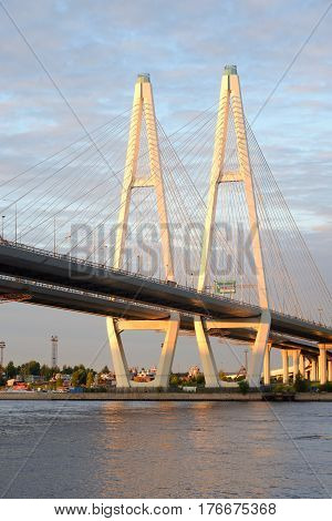 Cable stayed bridge and Neva river on the outskirts of St. Petersburg at evening Russia.