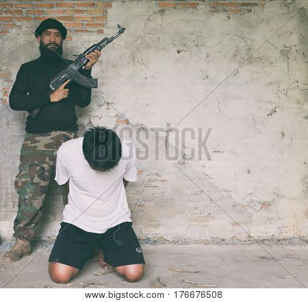 Terrorist In Balaclava Threatening With Gun To Man