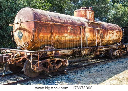 Vintage Rusted Railroad Tanker Car On Track Siding