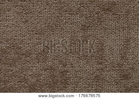 Brown fluffy background of soft fleecy cloth. Texture of textile closeup.