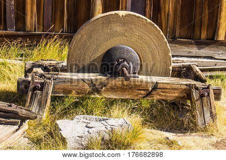 Vintage Grinding Wheel On Wood Base In Ghost Town