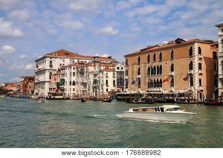 View Of Grand Canal With Houses And Motorboats In Venice, Italy