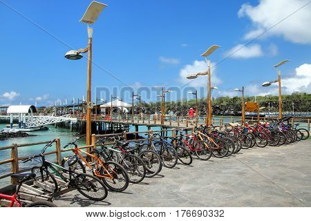 Bicycle parking on the waterfront in Puerto Ayora Santa Cruz Island Galapagos National Park Ecuador. Puerto Ayora is the most populous town in the Galapagos Islands.