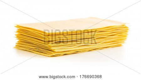 Raw lasagne sheets isolated on white background.
