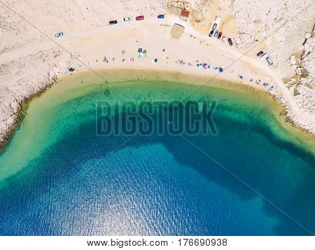 Aerial view of people enjoying at Drazica beach at island of Pag, Croatia.