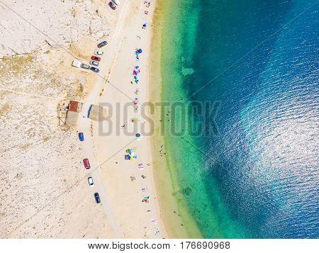 Aerial view of people enjoying at Drazica beach at island of Pag, Croatia.