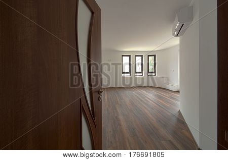Open door to a empty room. Interior. Welcome to new home concept
