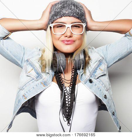 Young happy blond woman, studio shot