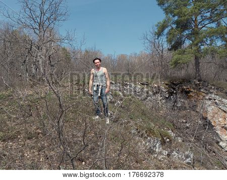 Funny Man in hat and sunglasses in forest, wide angle