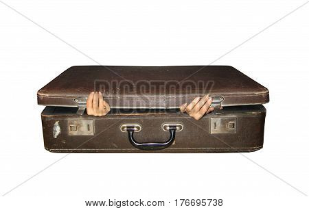 The woman hands are sticking out of old suitcase. White background.