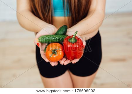 Beautiful Girl With Braces Holding Vegetables
