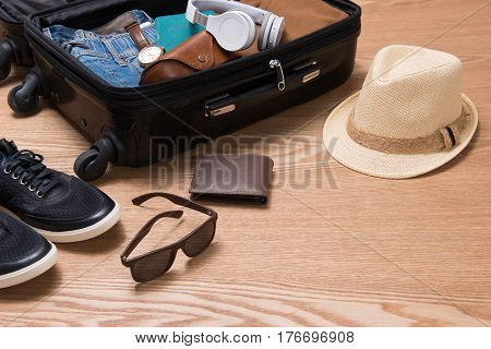 Travel And Vacations Concept. Open Traveler's Bag With Clothing, Accessories, Credit Card, Tickets A