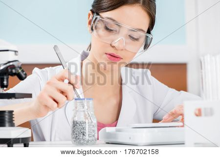 Female Scientist In Protective Glasses