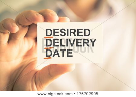 Businessman Holding Card With Ddd Desired Delivery Date Acronym Text