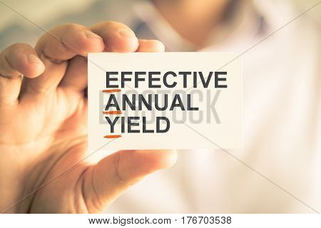 Businessman Holding Card With Eay Effective Annual Yield Acronym Text