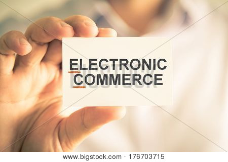 Businessman Holding Card With Ec Electronic Commerce Acronym Text