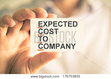 Businessman Holding Card With Ectc Expected Cost To Company Acronym Text