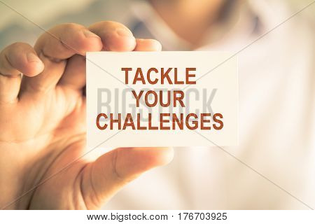 Businessman Holding Tackle Your Challenges Message Card