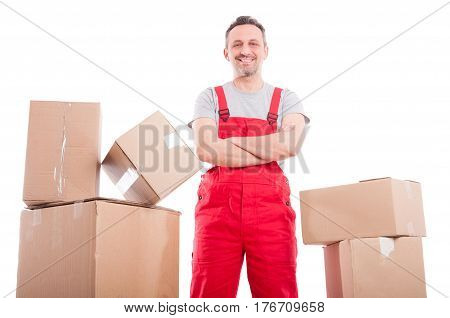 Mover Man Standing With Arms Crossed Between Cardboard Boxes