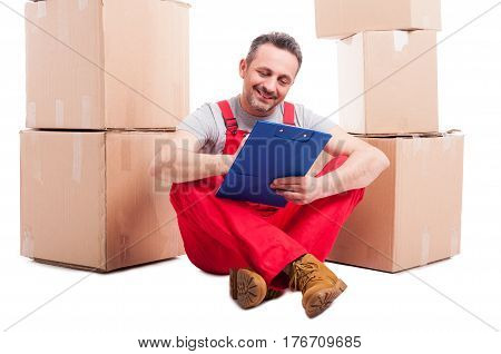 Mover Man Sitting On The Floor Holding Clipboard