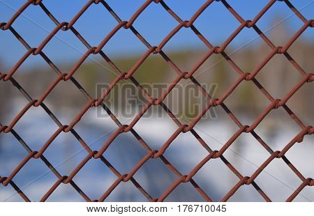 Rusted iron grid and Trans-Siberian Railway. Novosibirsk.