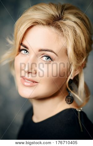 Close-up portrait of a beautiful middle-aged woman. Business woman portrait. Skincare, rejuvenation, cosmetics.