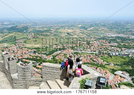 Tourists Enjoying The View From La Rocca Fortless On Borgo Maggiore, San Marino