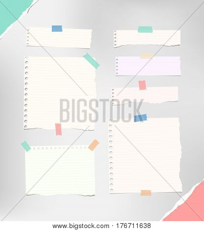 Ripped notebook, copybook, note strips, stuck with colorful sticky, adhesive tape, torn paper in corners.