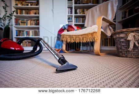 vacuum cleaner on grey carpet with copy space