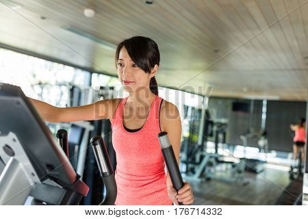 Woman running on Elliptical machine