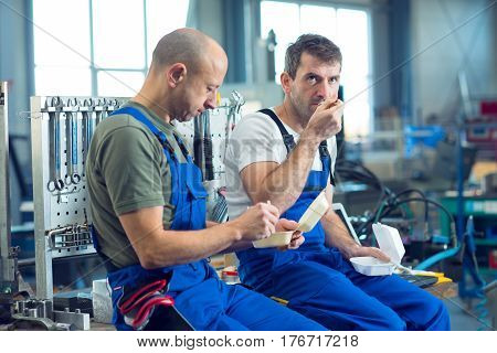 Two Worker In Factory Have A Break