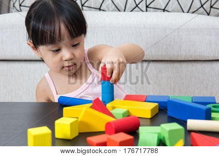 Asian Chinese Little Girl Playing Building Blocks At Home