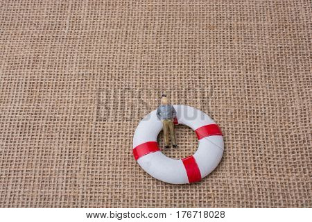 Little Figurine Man In A Life Preserver
