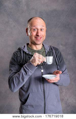 Young Baldheaded Man Drinking Coffee