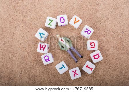 Figurine And The Colorful Alphabet Letter Cubes