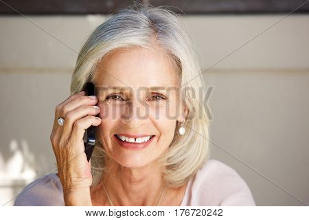 Beautiful Older Woman Talking On Cell Phone Outside