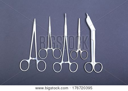 Medical and surgery instruments isolated in black mirror background.