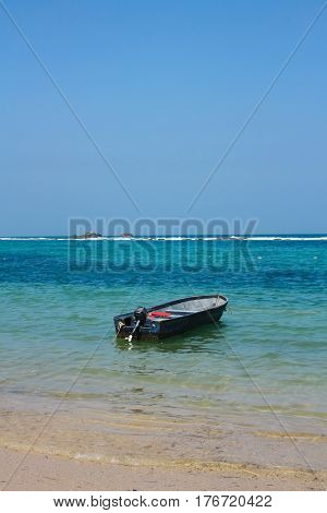 Boat in caribbean beach. Tayrona National Park is located in the Caribbean Region in Colombia. 34 km from the city of Santa Marta is one of the most important natural parks of Colombia.