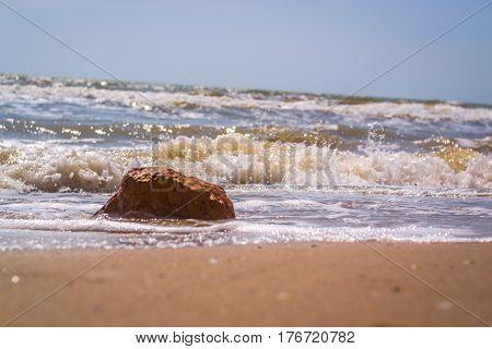 Pamorama of beautiful seascape. Rock on beach near the water