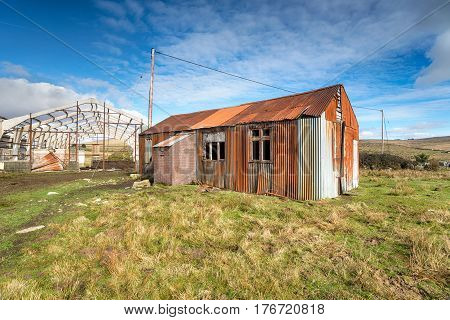 A rusty old corrugated metal shack on Dartmoor