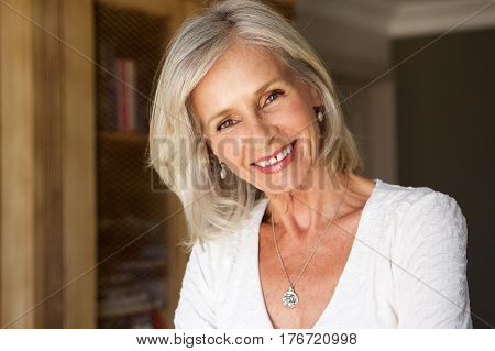 Beautiful Older Woman Standing In Study Smiling
