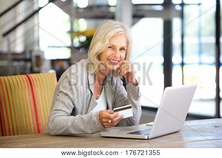 Beautiful Older Woman With Laptop Computer And Credit Card