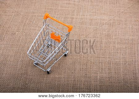 Shopping cart placed on a canvas background