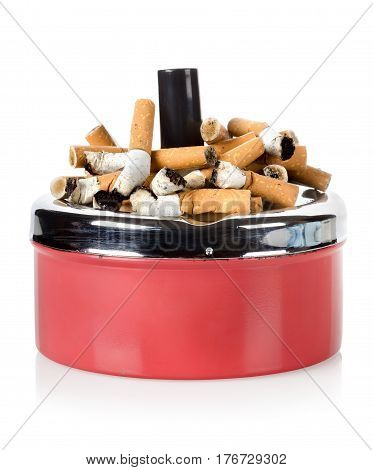 Cigarettes and old metal ashtray isolated on white background